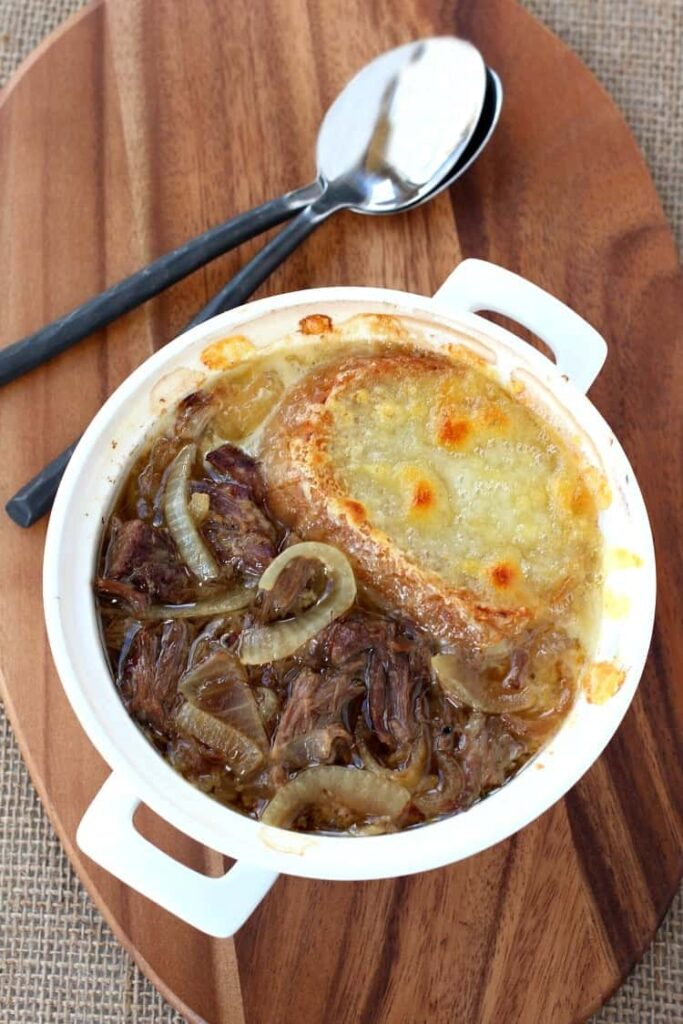 This Slow Cooker Beefy French Onion Soup is the best version of French Onion soup ever!