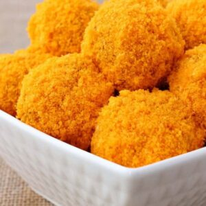 Stuffed Cheese Doodle Meatballs are coated in a cheese doodle crust!