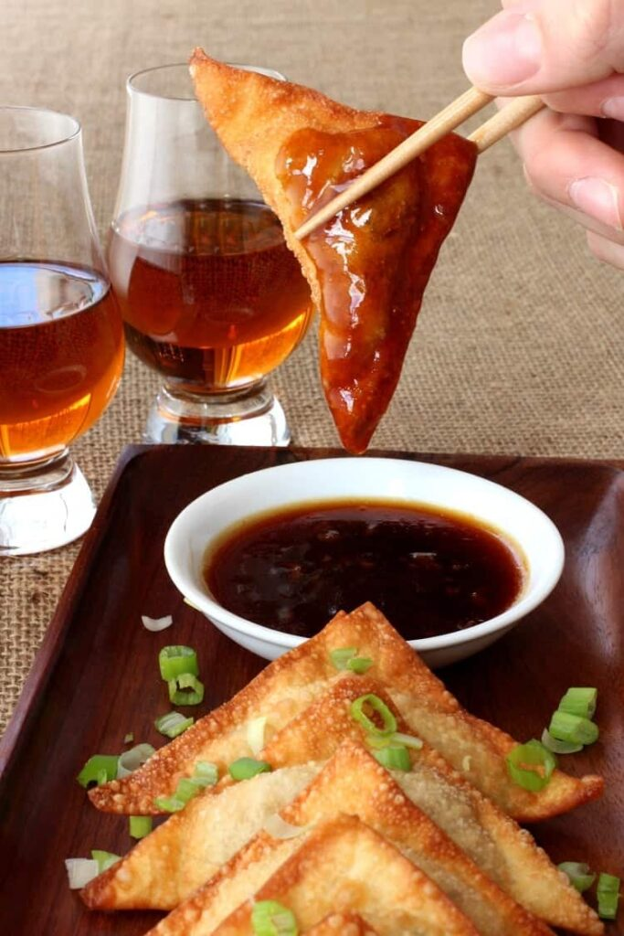 Whiskey Glazed Fried Dumplings are crispy wontons dipped in an addictive whiskey glaze!