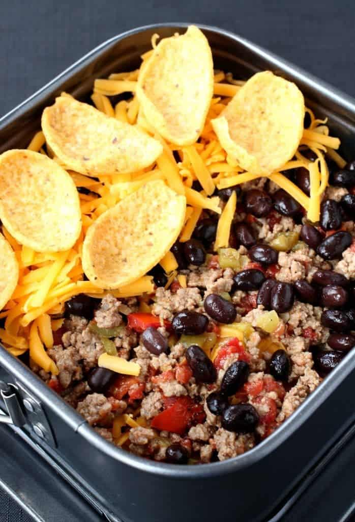 Layer these Trashcan Frito Nachos in a springform pan to make getting them out a breeze!