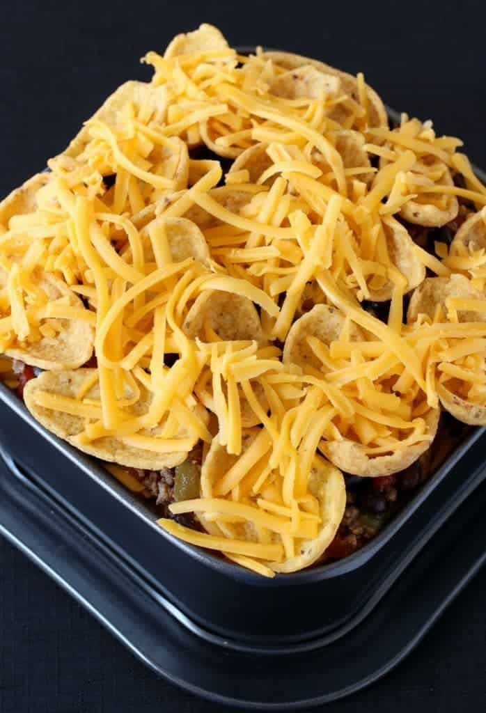 Trashcan Frito Nachos have layers of meat, cheese and fritos piled to the top!