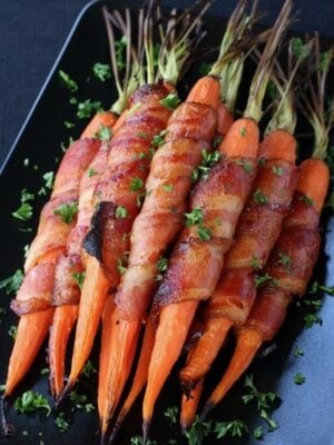 These Bacon Wrapped Maple Glazed Carrots are my favorite side dish to serve for Easter dinner!