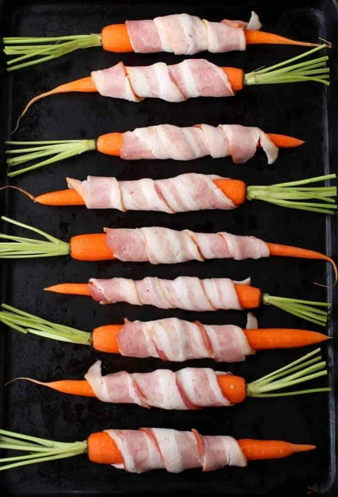 Bacon Wrapped Maple Glazed Carrots roast in the oven before glazing!