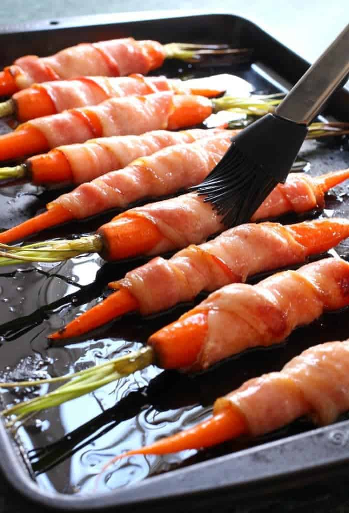 Glaze these Bacon Wrapped Maple Glazed Carrots then roast for an epic side dish!