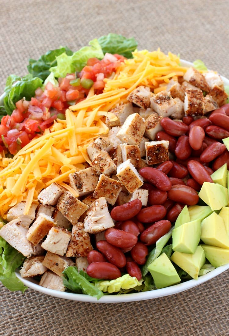 Chopped Chicken Taco Salad is a chopped salad recipe using beans, cheese and avocado