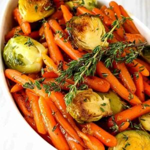 brussels sprouts and carrots with fresh thyme on top