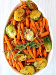 brussels sprouts and carrots in a white dish