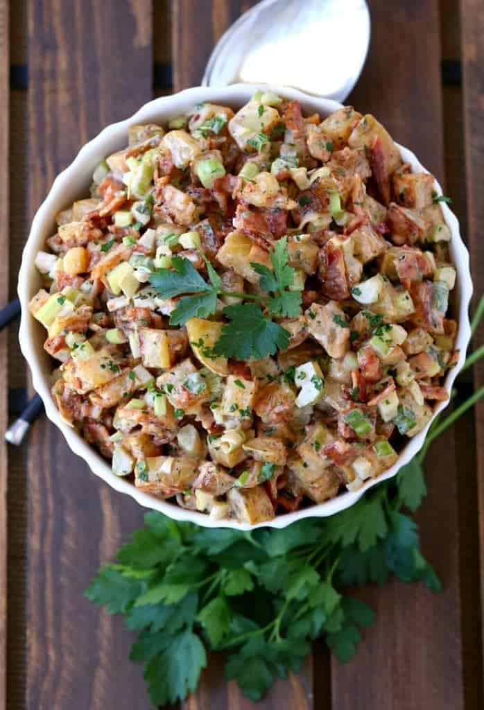 BBQ Bacon Potato Salad starts with roasting the potatoes, tossed in a creamy BBQ sauce!