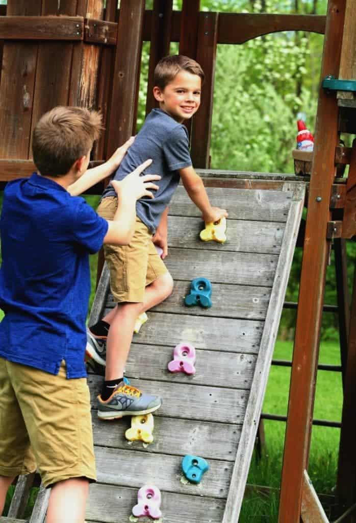 kids climbing on swing set