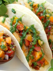 Fish Tacos with Tomato Salsa and Fresh Watercress Sauce are not only delicious but super healthy too!