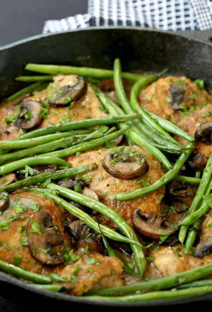 Skillet Chicken Thighs with Green Beans and Mushrooms in skillet