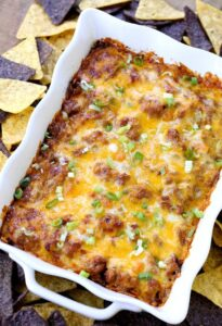 This Loaded Beef Burrito Layered Dip is the appetizer that eats like a meal!