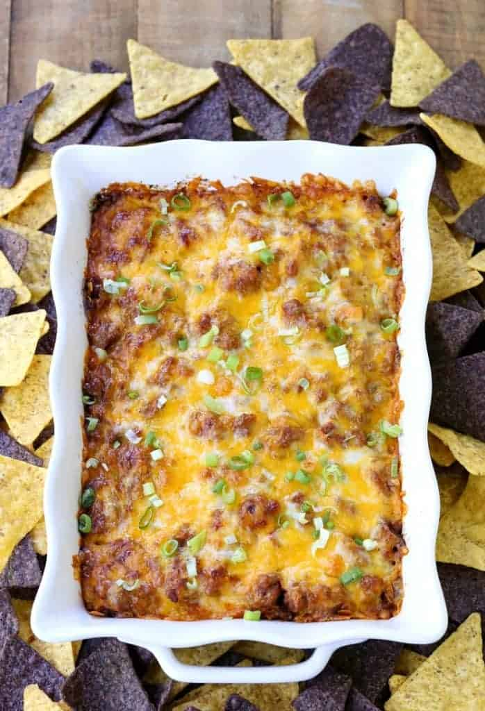 Loaded Beef Burrito Layered Dip has layers of beef, beans, rice and cheese!
