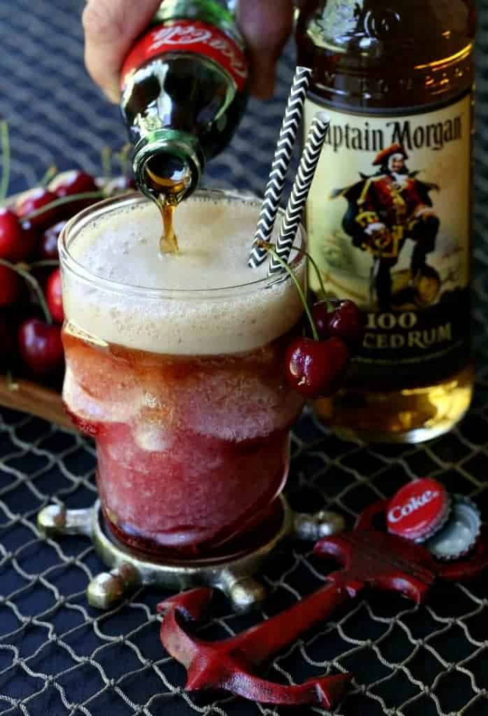 Frozen Rum and Cherry Coke pouring cola