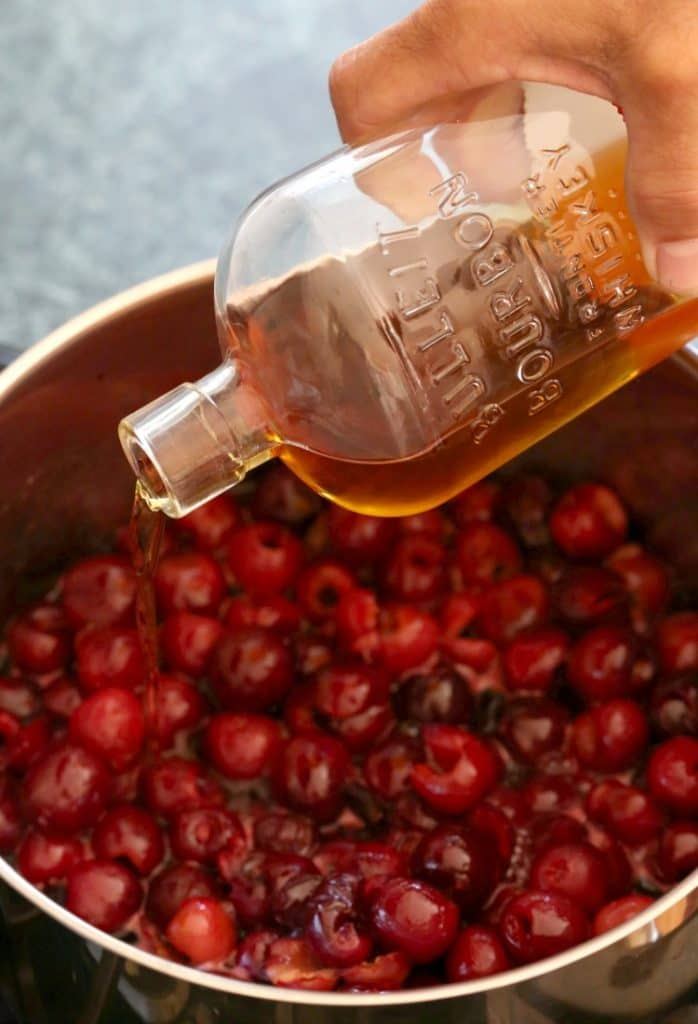 Pour in a good amount of bourbon to make this Bourbon Soaked Cherry Pie!