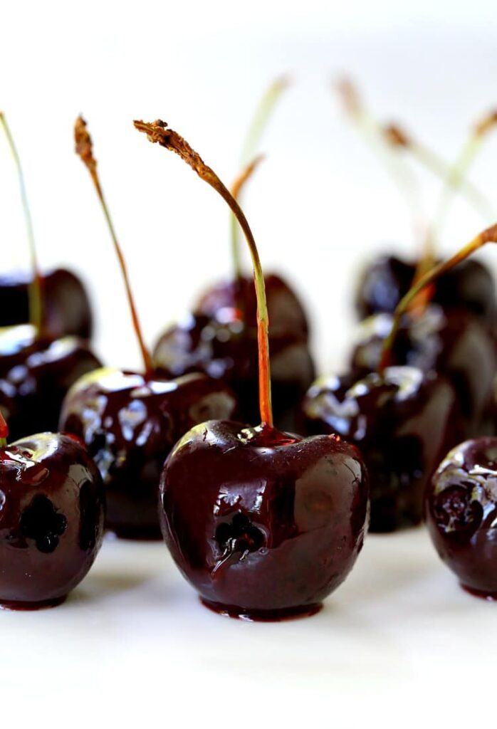 Candied Fireball Cherries on white plate