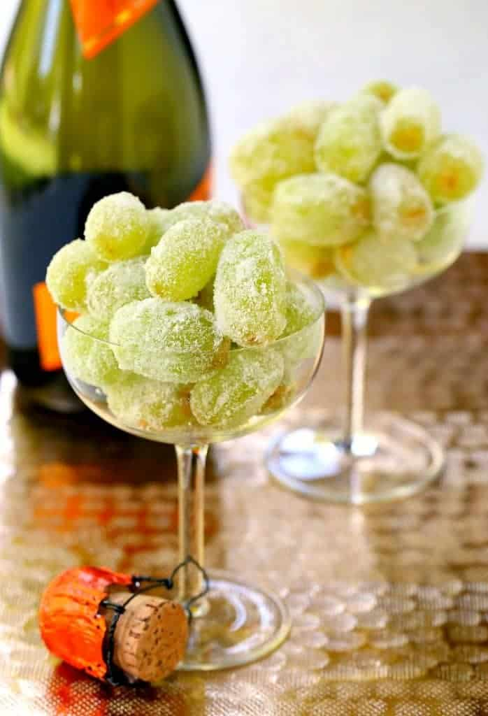 Kick up your New Year's Eve food with these Sugared Prosecco Grapes! A three ingredient, boozy dessert that's perfect for your New Year's celebration! #newyears #boozydessert