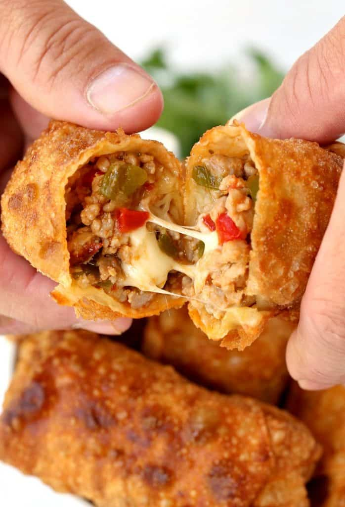 Make these Italian Egg Rolls with sausage, peppers and a crazy cheesy center!
