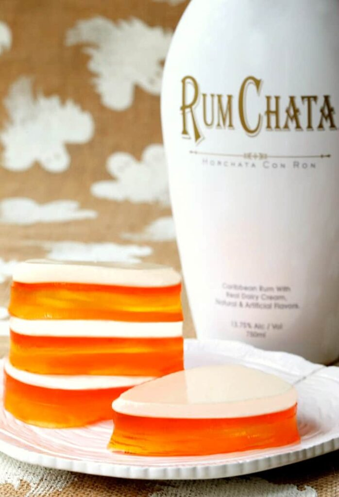 RumChata Candy Corn Jello is a Jello shot recipe that can be customized for any holiday!