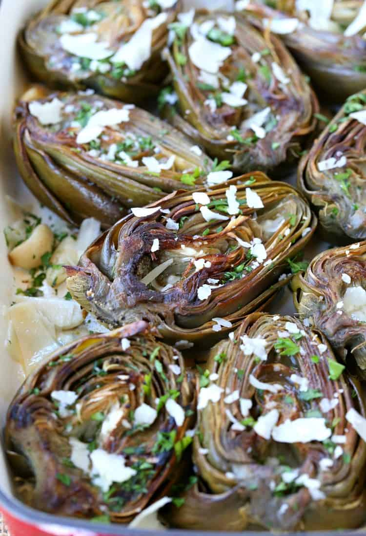 Roasted artichokes in a baking dish