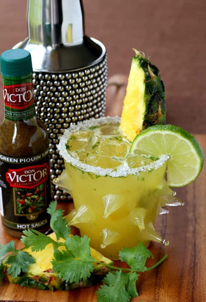 This Spicy Pineapple Cilantro Margarita uses a mild green pepper sauce for the perfect amount of heat!