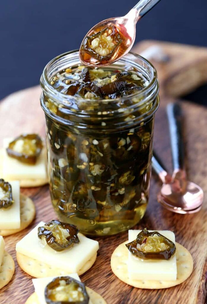 Candied Jalapeños in a jar with crackers