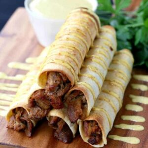 This Honey Mustard Pulled Pork Taquitos recipe is perfect for appetizers or dinner!