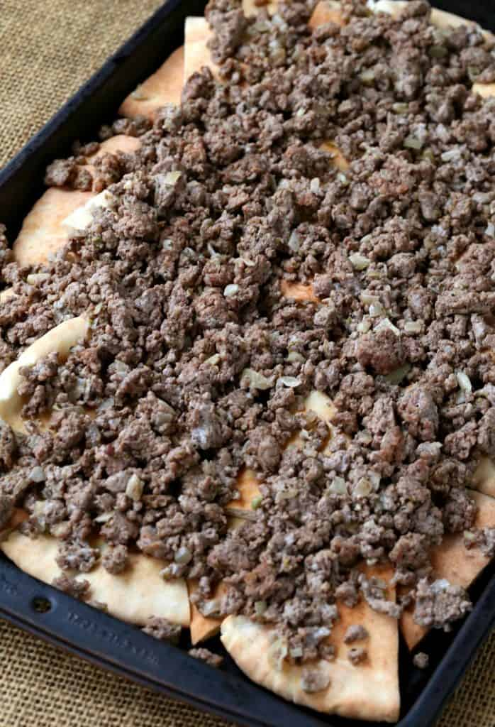 a mixture of ground beef and lamb top this greek nacho recipe
