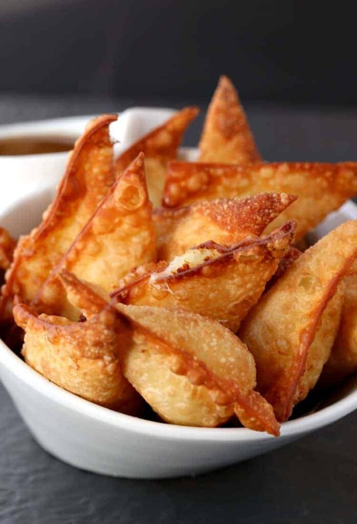 Serve these Fried Poutine Wontons for appetizers made with leftover mashed potatoes!