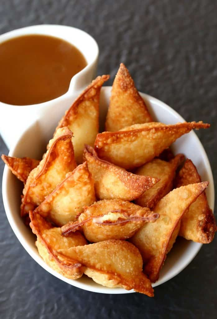 These Fried Poutine Wontons are an appetizer recipe that can be made with leftover mashed potatoes