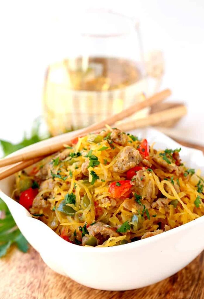 Sausage and Pepper Spaghetti Squash Stir Fry is a stir fry recipe made with roasted spaghetti squash, sausage and peppers