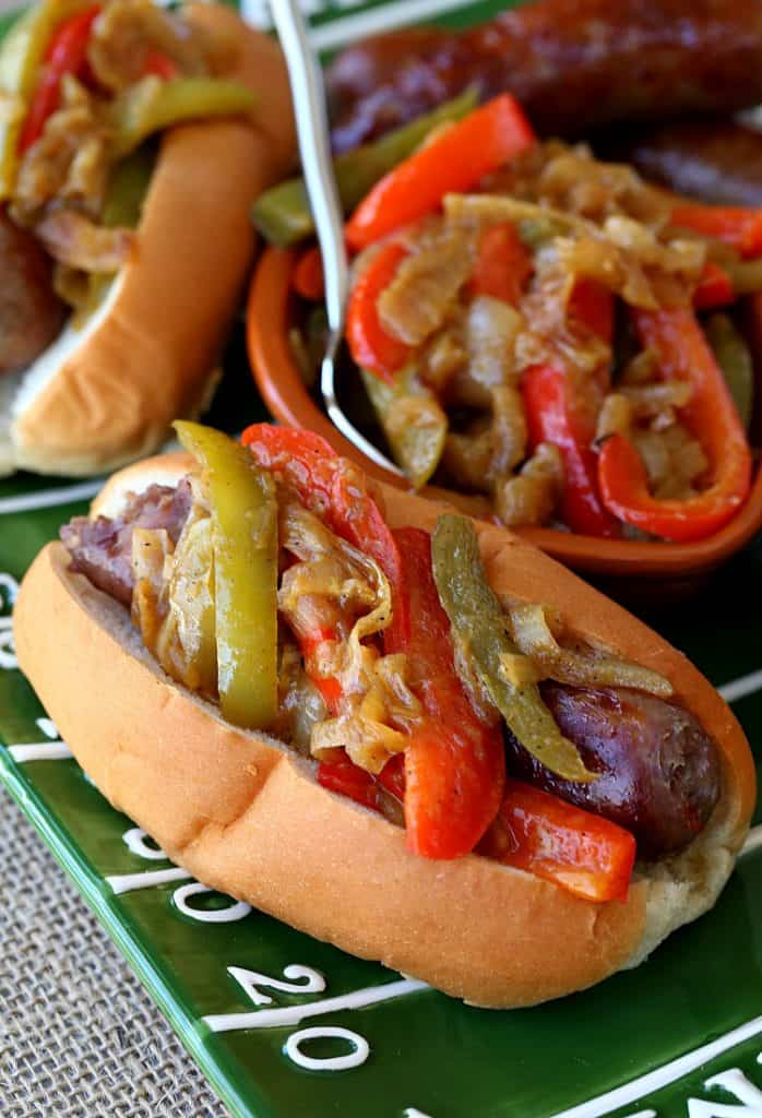 German Style Sausage and Peppers are grilled bratwurst topped with a pepper and onion topping
