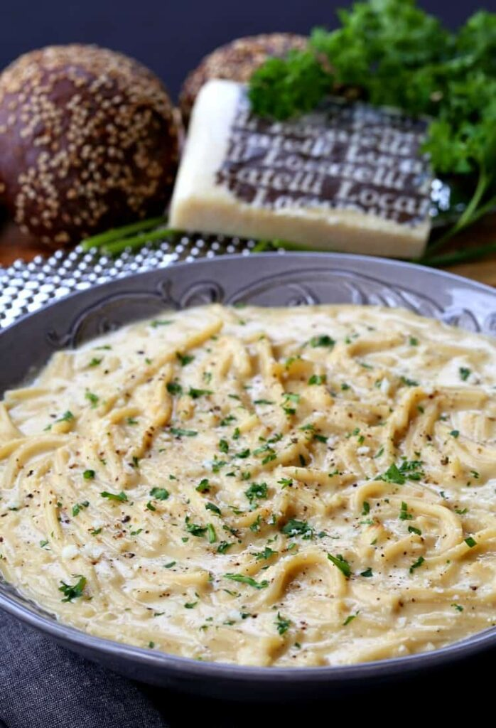 Cacio e Pepe Chowder in a bowl with parsley
