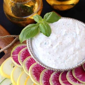 Fresh Ricotta Vegetable Dip in bowl with wine glasses