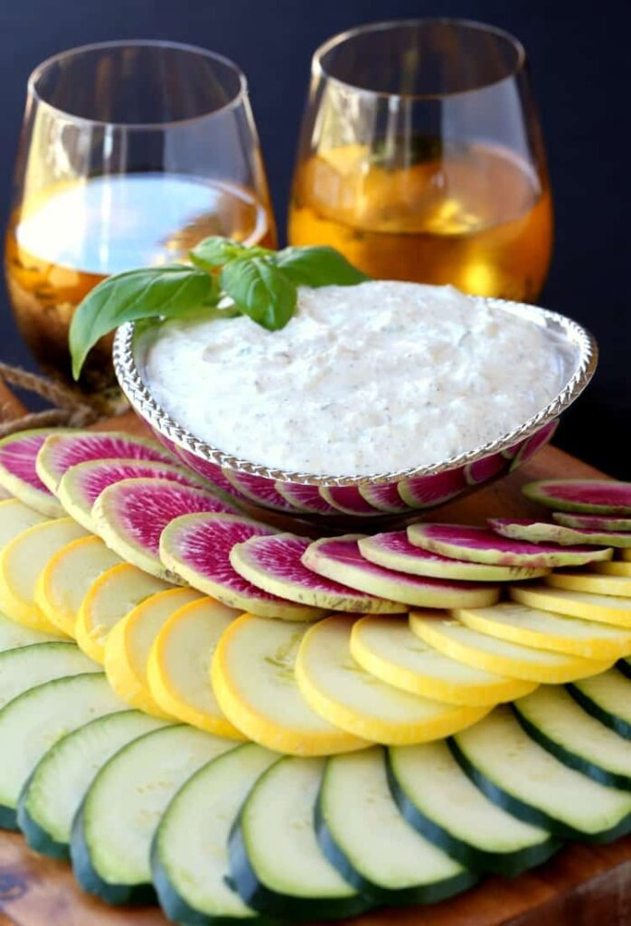 Fresh Ricotta Vegetable Dip with wine glasses