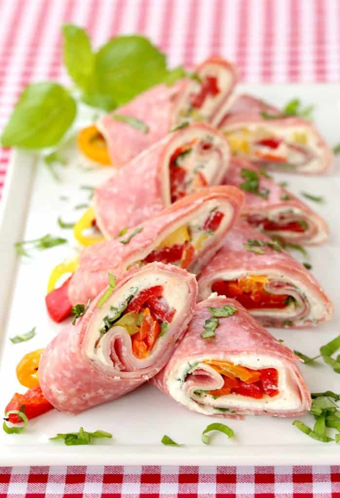 Italian Deli Roll Ups on a plate with chopped basil