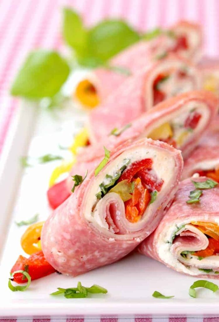 Italian Deli Roll Ups sliced for serving on a white plate