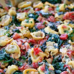 Skillet Tuscan Spinach Tortellini in skillet from side