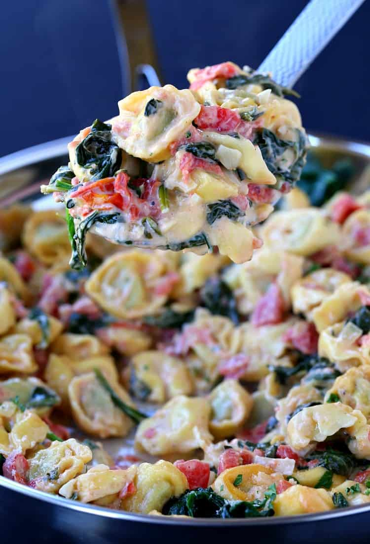 Skillet Tuscan Spinach Tortellini on a big spoon