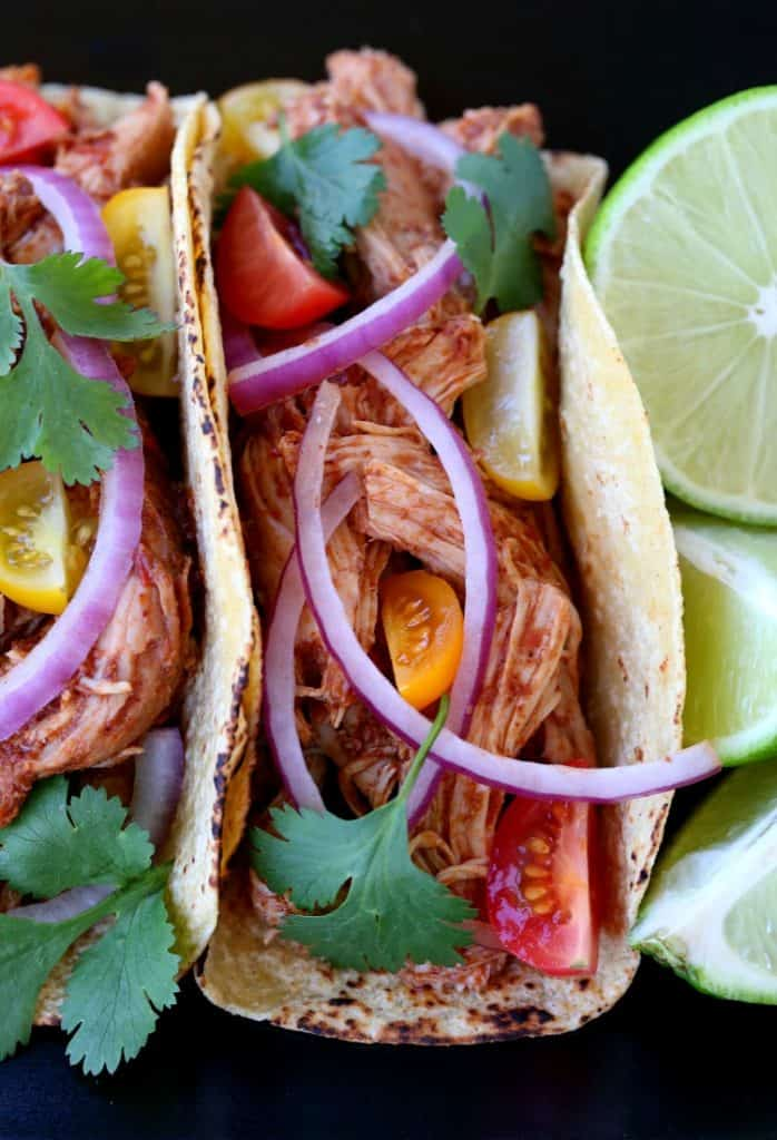 Turkey mole tacos from the top with onions and tomatoes