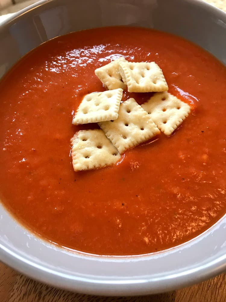 Tomato Soup with crackers in a bowl