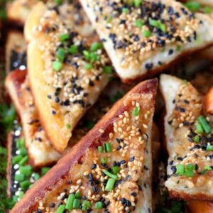 Bacon Shrimp Toast stacked on a plate