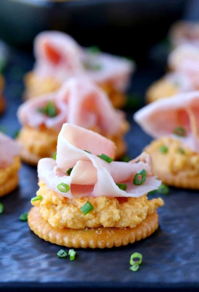 Ham and Pub Cheese Crackers close up on slate