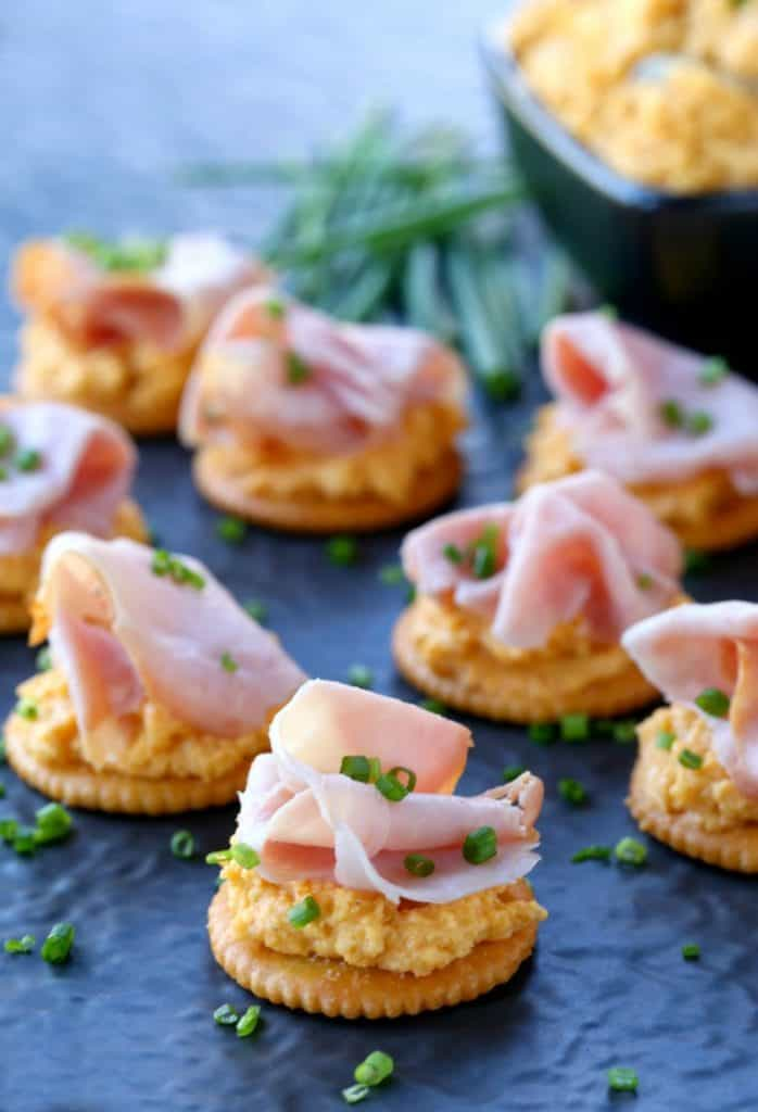 Ham and Pub Cheese Crackers on a cheese board with bowl