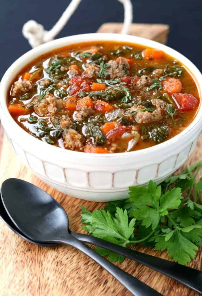 low carb sausage and vegetable soup in white bowl