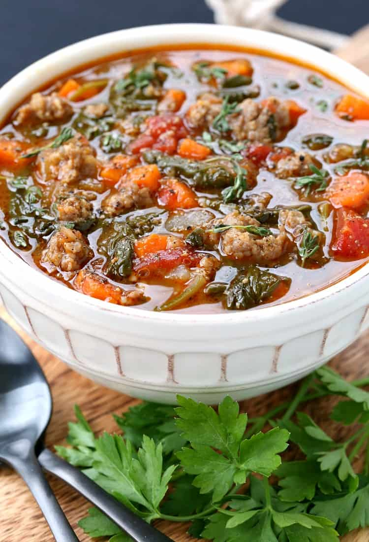 Low Carb Sausage Vegetable Soup in a bowl close up with parsley