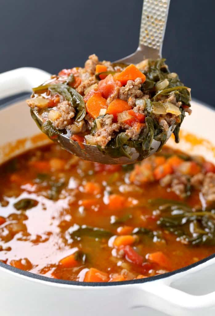 Low Carb Sausage Vegetable Soup in a ladle