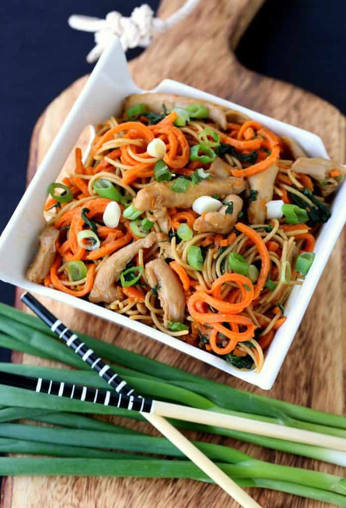 Veggie Heavy Chicken Lo Mein in a bowl with scallions and chop sticks