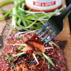 Oven Baked Asian BBQ Salmon with sauce and a fork bite