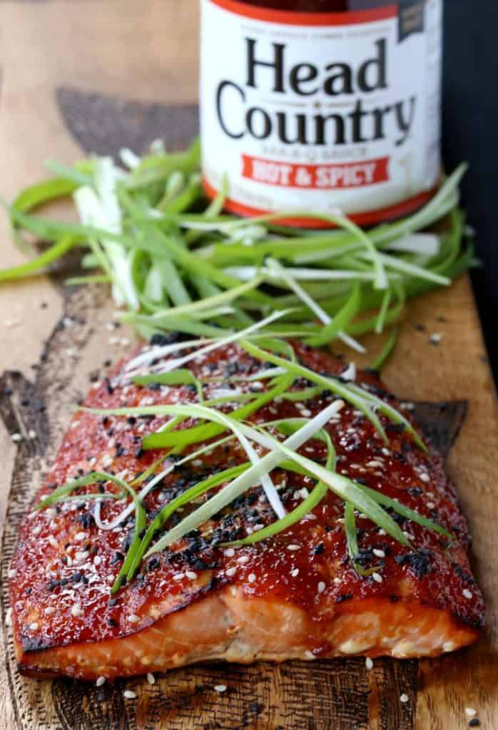 baked asian bbq salmon on board with sauce